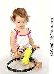 Girl with a racket and balls.