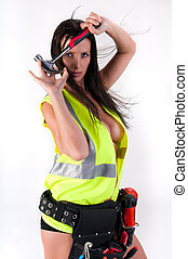 Sensual with hammer - Very sensual woman with safety vest...