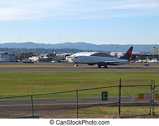 Take-off at PDX - An American passenger jet taking off at...