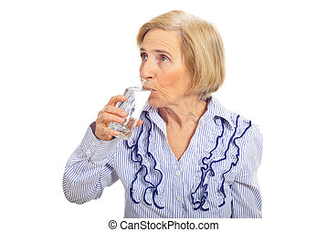 Aged woman drinking glass of water and looking away isolated...