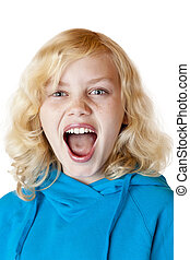 Young blond girl screams loudly at camera. Isolated on white...