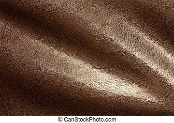 Brown leather background closeup