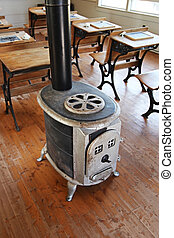 Inside of old school house with old wood stove