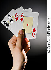 playing-card - A man showing a playing-card trick