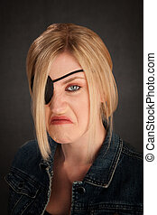 One Eyed Lady - Angry blonde girl with eyepatch on grey...