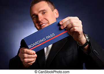 Business man holding a boarding pass - Elegant business man...