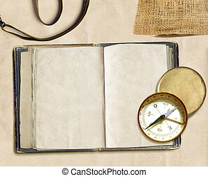 log book - ancient logbook and compass on faded paper,...