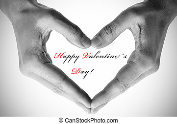 happy valentines day - man hands forming a heart and the...