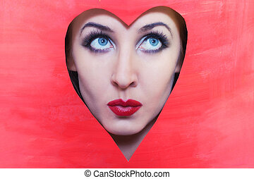 Face of young woman in red heart