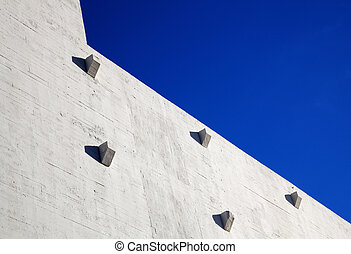 abstract abutment wall sky - Portion of a sun lit concrete...
