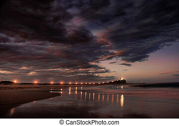 lighthouse and breakwater at night - breakwater or jetty...
