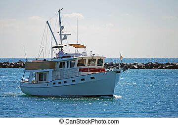 Charter Fishing Boat - Charter fishing boat heading back to...