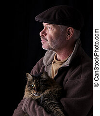 Man holding cat - Older gentleman holding his cat