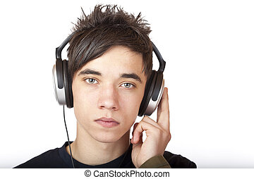Male Teenager with headphone listening seriously to language cd