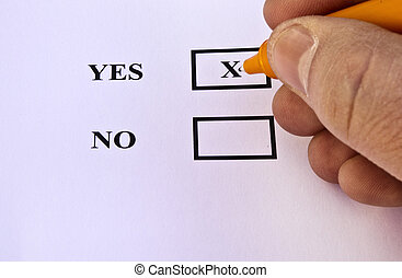 Vote Yes - Human hand voting yes with orange pen Great...