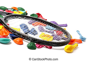 Coloured balloons and tennis racket New