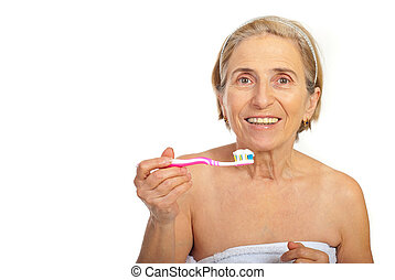 Smiling senior woman with tooth brush - Smiling senior woman...