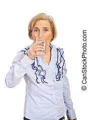 Aged woman drinking water - Aged woman drinking a glass with...