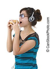 woman with hamburger, sunglasses and head phones - pretty...