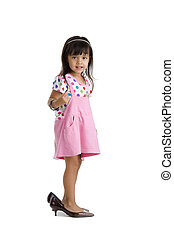 little girl with oversized shoes - cute little kid with...