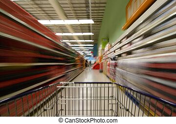 Supermarket blur - A supermarket scene with shopping cart...