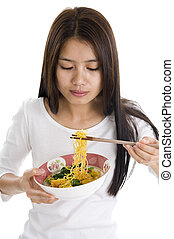asian woman eating with chop sticks, isolated on white