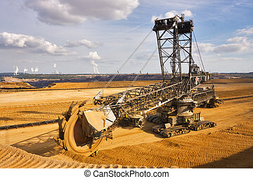 Giant bucket wheel excavator taking away the layers of...