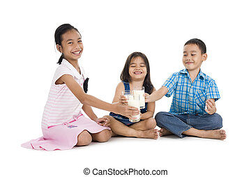 siblings cheering with milk, isolated on white background
