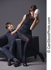masked relationship - couple proplem - man and woman in...