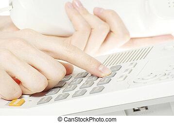 telephone keypad - finger with  white telephone keypad