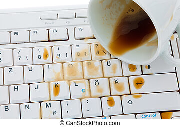 Cup of coffee spilled on keyboard. - Cup of coffee spilled...