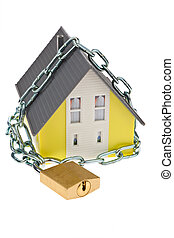 Detached with chain - A detached house with a chain and lock...