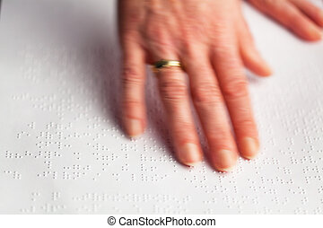 Fingers and Braille. Blind read.
