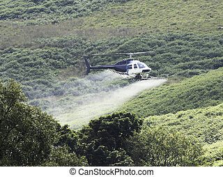 Crop Sprayer Helicopter - Crop spraying helicopter in the...