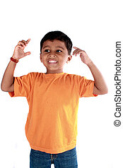Happy Indian Kid - A happy Indian kid, isolated on white...