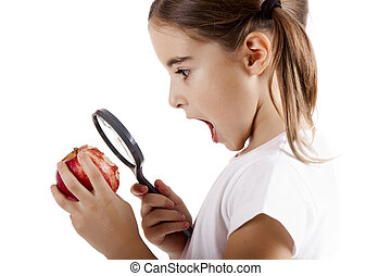 Inspecting microbes - Little girl with a magnifying glass...
