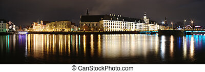 Night panorama with buildings and river