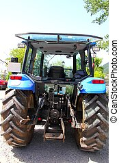 Tractor back end view big wheels blue color outdoor