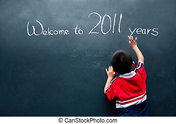 Welcome to 2011 years - Boy writing on the wall and welcome...