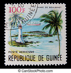 canceled postage stamp - post stamp printed in Guinea shows...