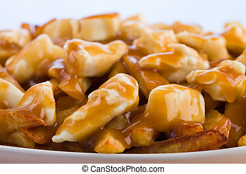 Macro poutine - Poutine meal made with french fries, cheese...