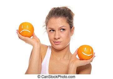 Woman with two oranges  different emotions isolated in white