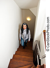 Woman climb interior stairs - Woman climb up interior wooden...