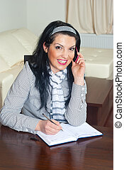 Executive woman working home sitting on chair speaking at...