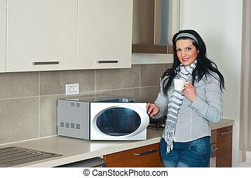 Attractive woman in modern kitchen