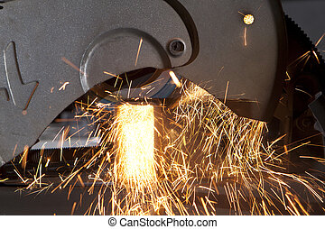metal cutting saw throwing sparks all over