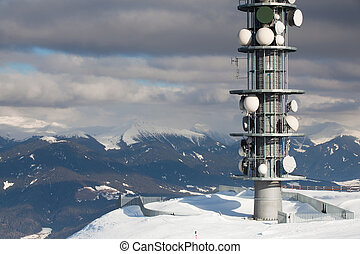 Communication antenna tower and satellite dishes against...
