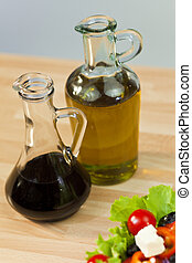 Olive Oil and Balsamic Vinegar With Fresh Salad - Bottles of...