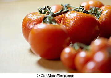 ripe of tomatoes on kitchen table