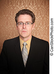 Serious Businessman - Serious businessman in suit on brown...